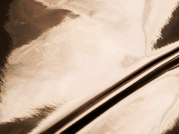 Öliger goldbeschaffenheitshintergrund mit kopierraum