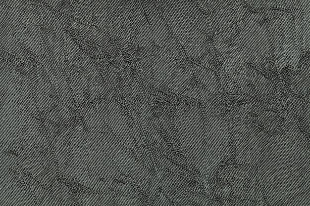 Olivgrüner hintergrund vom textilmaterial