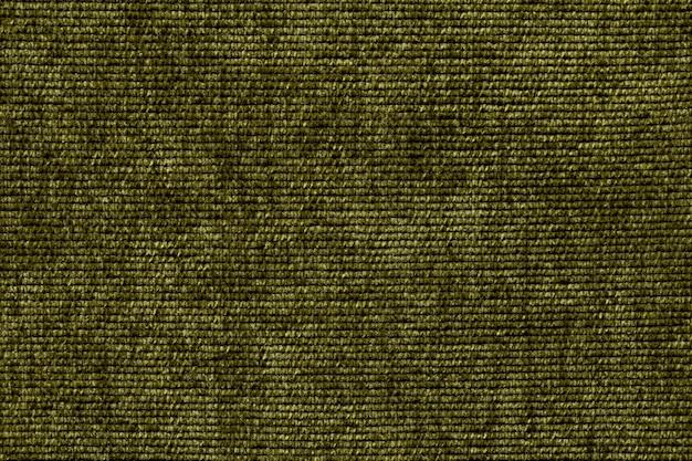 Olivgrüner hintergrund von einem weichen textilmaterial