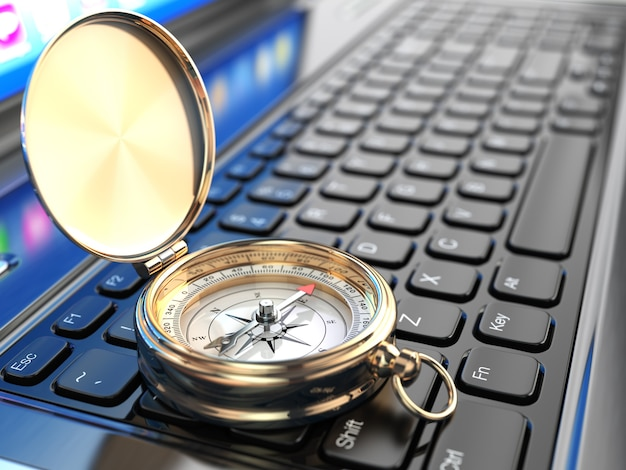 Online-navigation. kompass auf laptop-tastatur. 3d