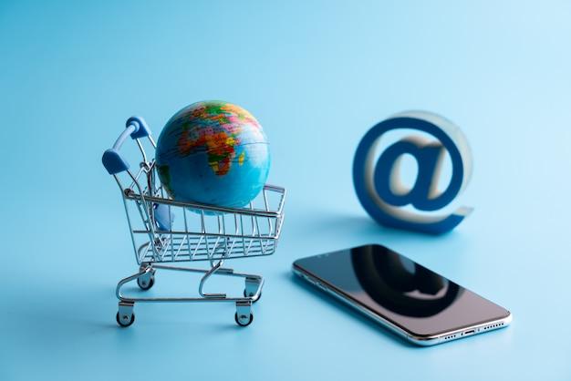 Online-shopping-ikone mit globus für globales konzept