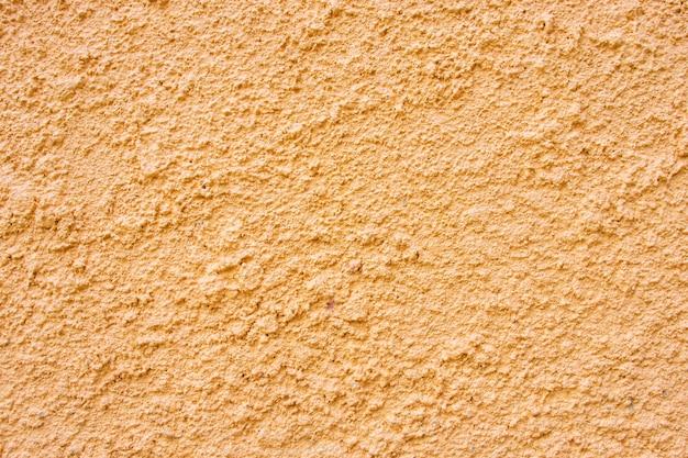Orange betonwandbeschaffenheit