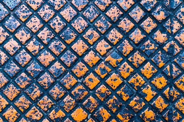 Orange farbbeschaffenheit und -hintergrund der metallplatte
