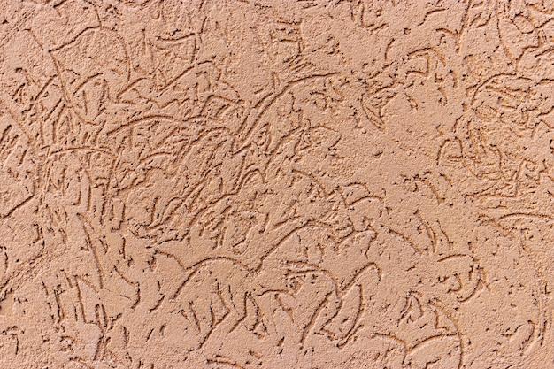Orange fassadenstuckhintergrund. dekorativer hintergrund des monolithischen stucks. silikat-zement-wandputz.