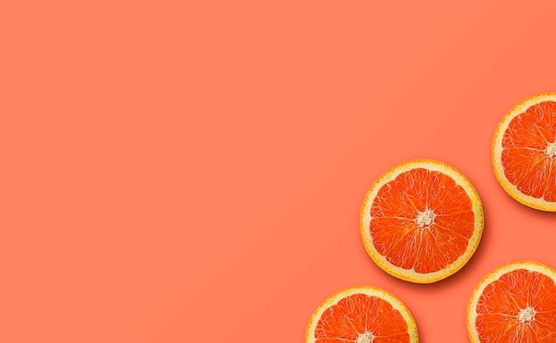 Orange frucht auf gelb- und pfirsichfarbhintergrund