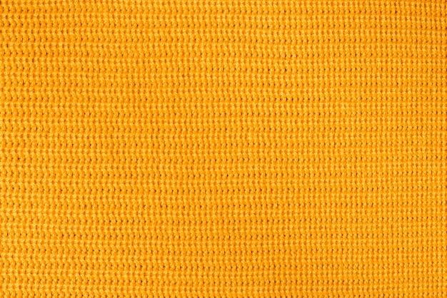 Orange gestricktes muster von acrylgarnen
