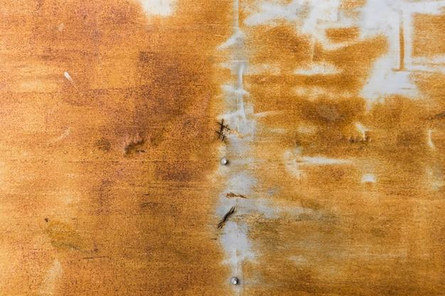 Orange getragener rostiger metallbeschaffenheitshintergrund