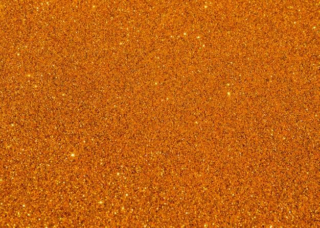 Orange glitzernde textur hintergrund abstrakt