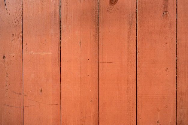 Orange holzwandhintergrund und -beschaffenheit.