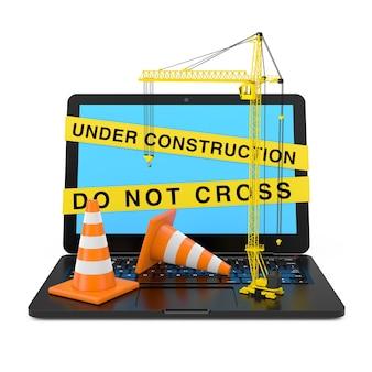 Orange leitkegel und yellow tower crane über laptop mit under construction tape auf weißem hintergrund. 3d-rendering