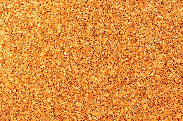 Orange leuchtendes leuchtendes effektkonzept, glitzertexturhintergrund, sandpapper hochdetailliertes oberflächenfoto