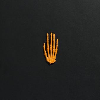Orange skelett hand in der mitte