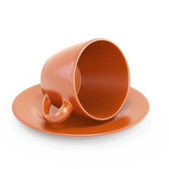 Orange tasse auf seiner seite isoliert