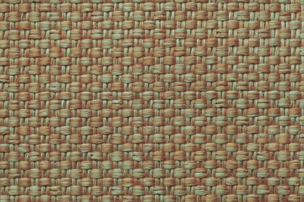 Orange textilhintergrund mit kariertem, struktur des gewebemakros,