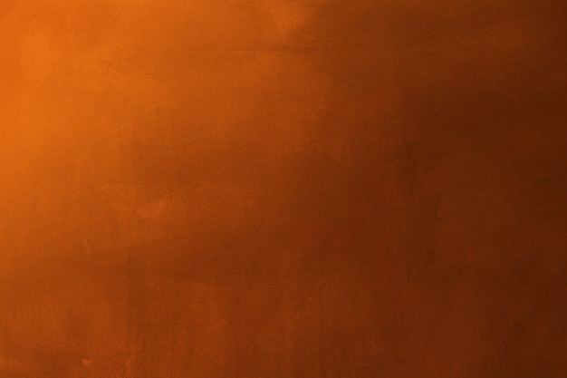 Orange und dunkler zementbeschaffenheitswandhintergrund
