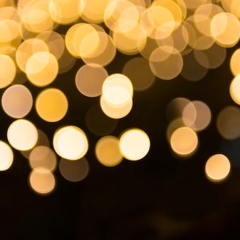 Orange und gelbe unschärfe-weihnachtslichter können für den hintergrund verwendet werden