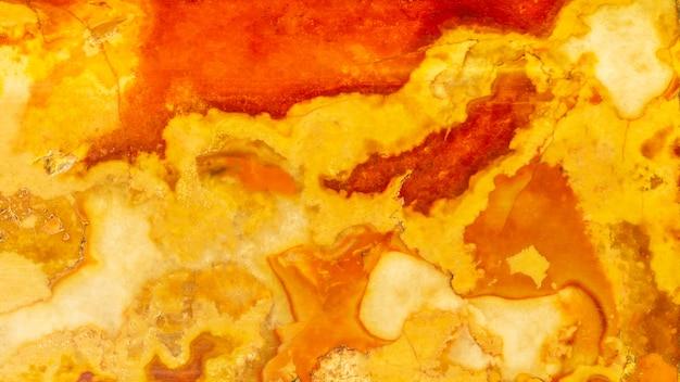Orange und roter marmorwandoberflächenhintergrund