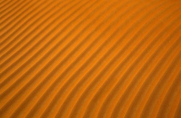 Orange wüstensandmusterhintergrund mit linien