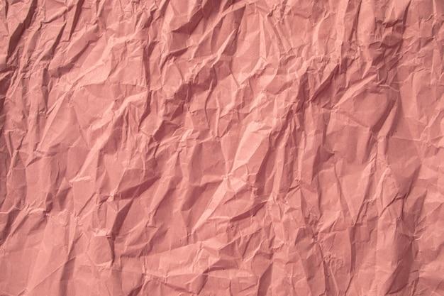 Orange zerknitterter papierabschluß herauf beschaffenheitshintergrund