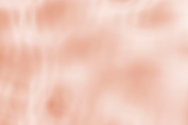 Orangefarbener hintergrund, wasserreflexionstextur