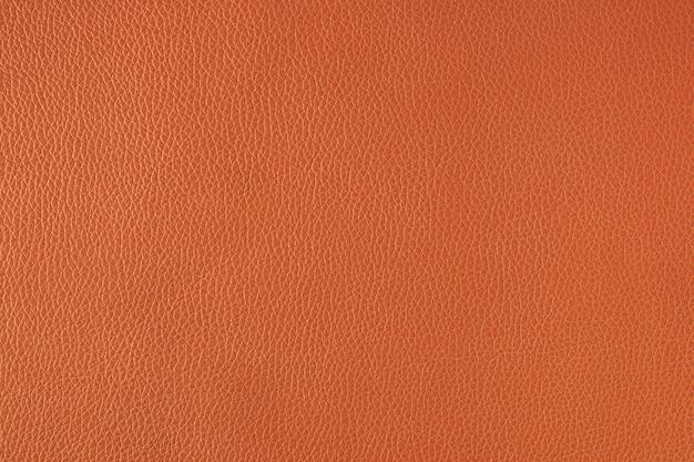 Orangefarbener strukturierter hintergrund aus feinem leder