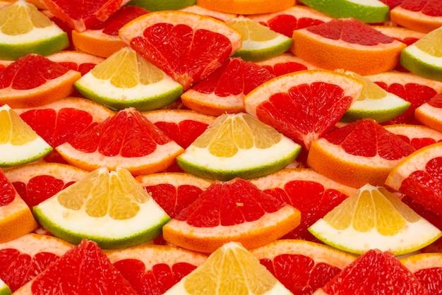 Pampelmuse und grapefruit saftige scheiben hintergrund.