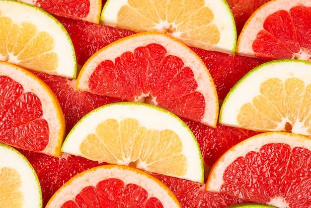 Pampelmuse und grapefruit saftige scheiben.