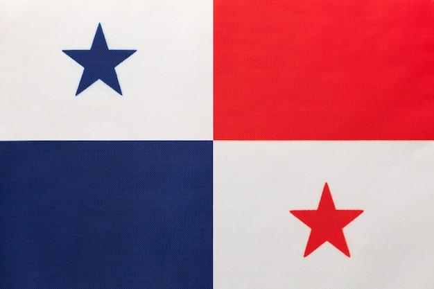 Panama national stoff flagge mit emblem, textil-hintergrund, symbol der internationalen welt südamerika land,