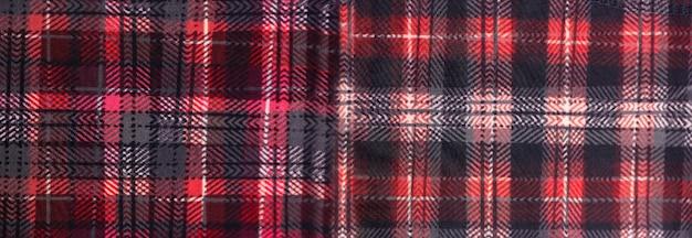 Panoramamuster aus rotem und schwarzem stoff im wechsel für den hintergrund.