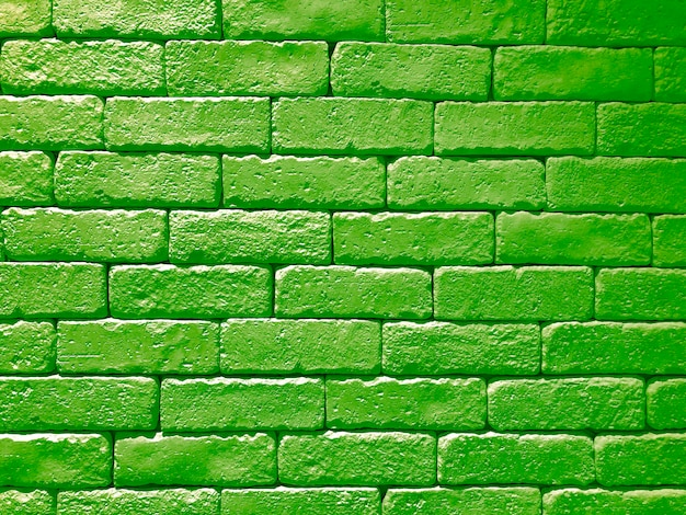 Panoramische hintergrundbeschaffenheit der breiten grünen backsteinmauer. haus und büro design kulisse
