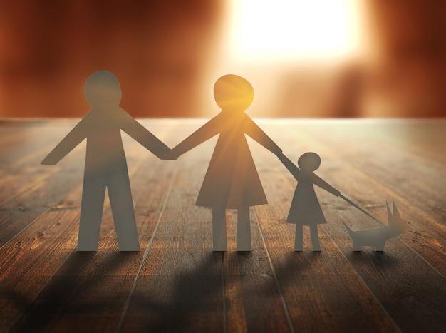 Papierfamilie auf holztisch bei sonnenuntergang