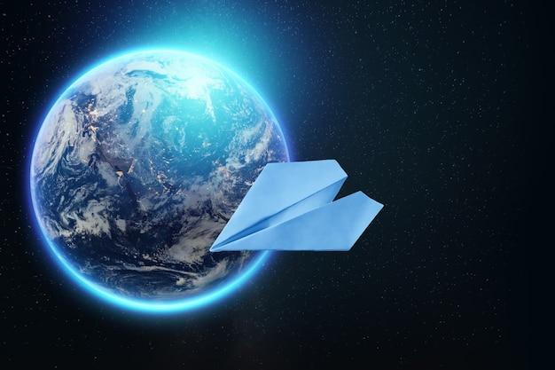 Papierflugzeug auf dem hintergrund des globus