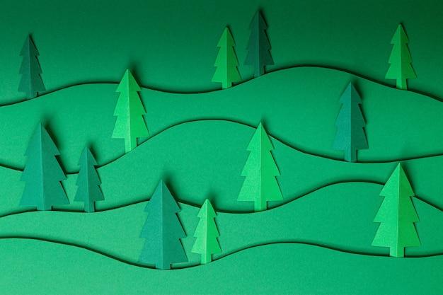 Papiergrafik der 3d-pop-out-weihnachtsbäume auf grün