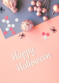 Papierhandwerk halloween flach lag auf rosa und grauer geteilter papierwand mit text