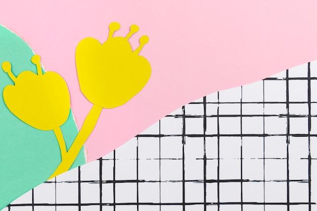 Papierhandwerkshintergrund mit gelber blume