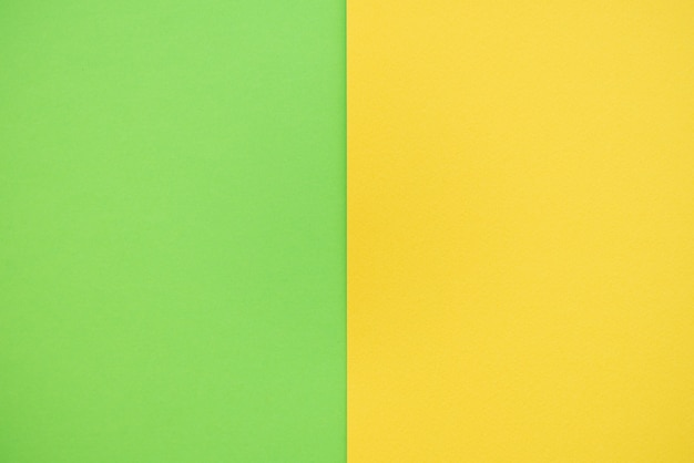 Papierhintergrund von zwei farben gelb und grün.