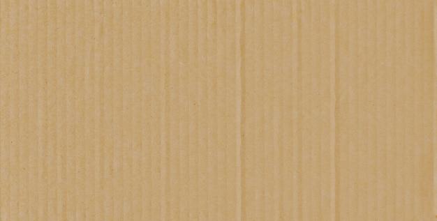 Papppapierbeschaffenheit des kastens oder der wand im hintergrund.