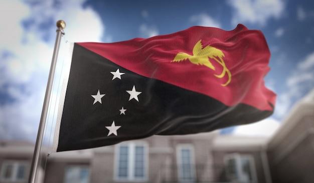 Papua-neuguinea-flagge 3d-rendering auf blauem himmel-gebäude-hintergrund