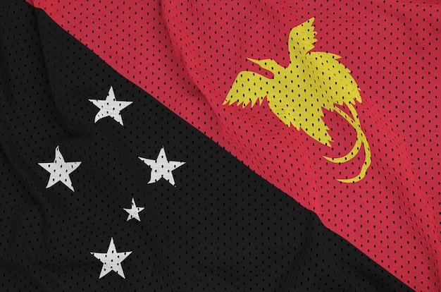 Papua-neuguinea flagge gedruckt auf einem polyester-nylonnetz