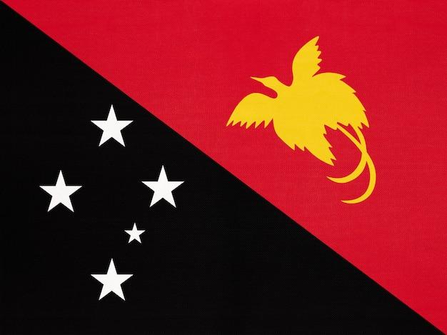 Papua-neuguinea nationale gewebeflagge, textilhintergrund symbol des weltozeanien-landes