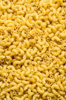 Pasta hintergrund. ungekochte teigwaren. draufsicht. die textur der nudeln