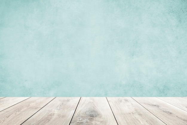Pastellblaue wand mit holzbodenprodukthintergrund