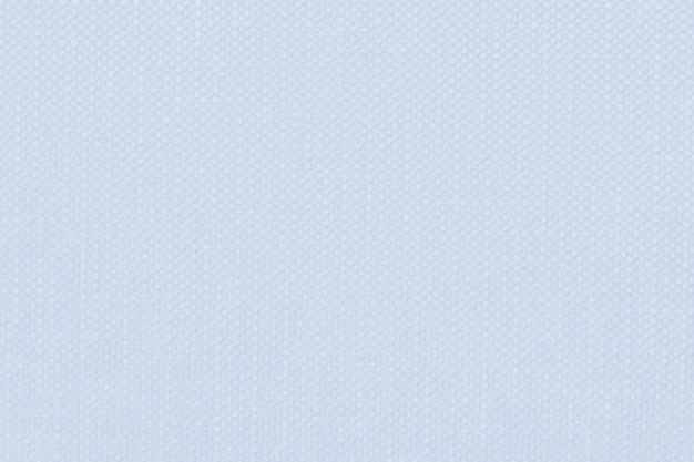 Pastellblauer strukturierter textilhintergrund mit prägung