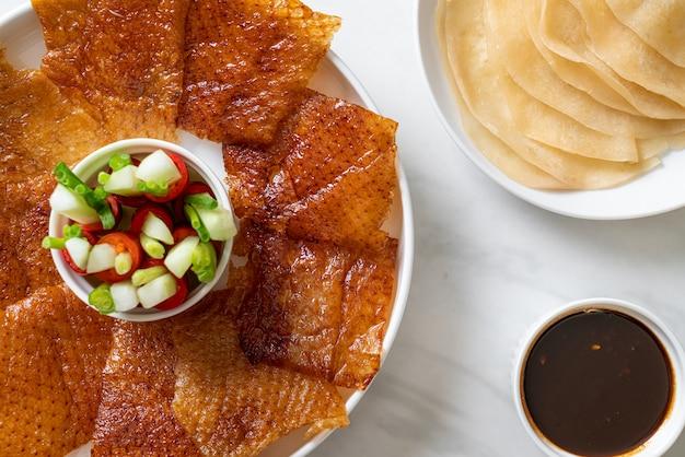 Pekingente mit sauce und zutaten