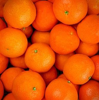 Perfekter hintergrund der reifen clementinen