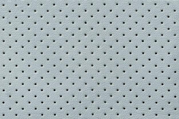 Perforierter hellblauer lederbeschaffenheitshintergrund, hintergrund von der faltenhaut,