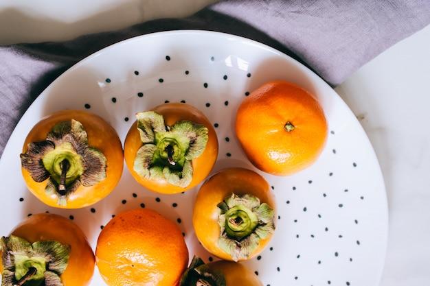 Persimmon und mandarine