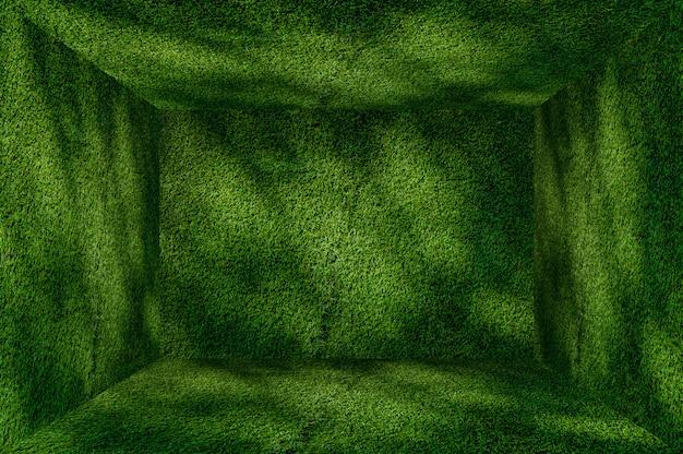 Perspektiven-gras-grünwand- und -bodeninnenraumhintergrund