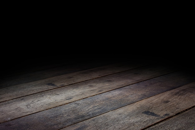 Perspektivischer hintergrund der dunklen plankenholzbodenbeschaffenheit für anzeige oder montage des produkts
