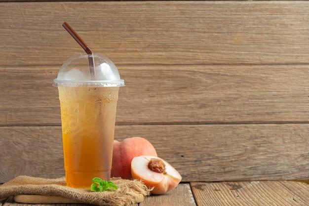 Pfirsich-tee pfirsich-lebensmittel- und getränkeprodukte lebensmittelernährungskonzept.